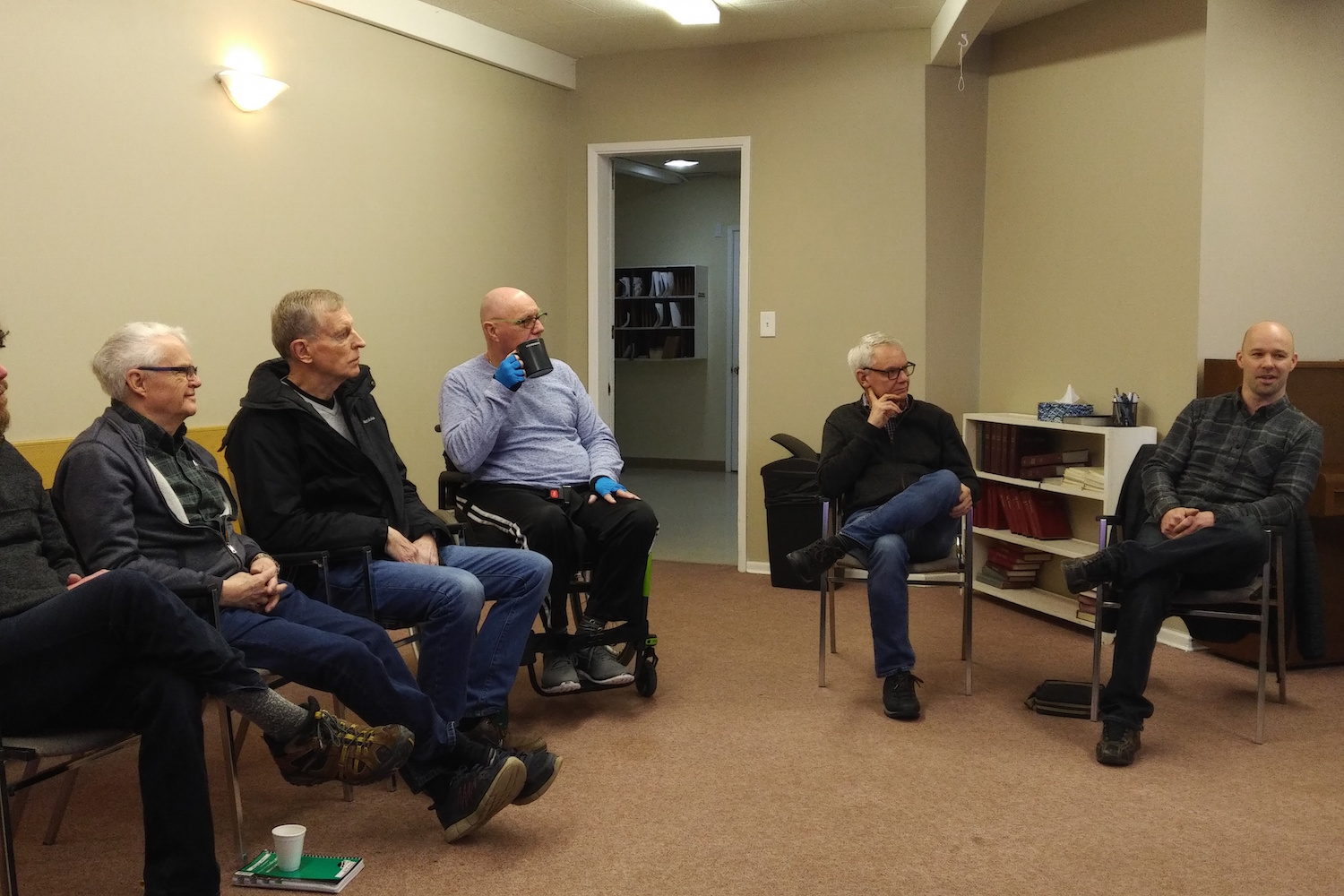 Chris McClure sharing at the Edmonton Ministerial Cluster